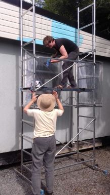 lindsey and sain prepping mural